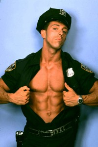 One of the best male strippers from Chicago dressed as a cop.